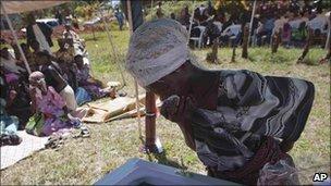 A mourner at the funeral of the Ugandan gay activist, David Kato