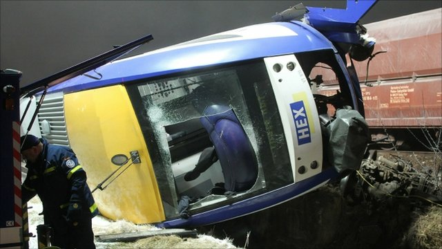 A damaged train on its side