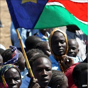 A Sudanese young man waves the regional flag of southern Sudan (image from 15/1/11)