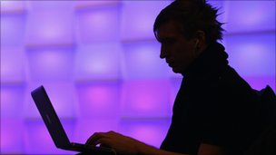 Silhouette of man with a laptop