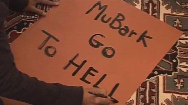 Man writes protest placard