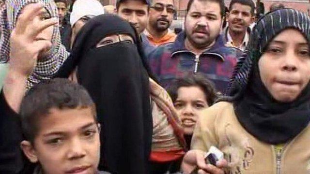 Men, women and children protesting in Cairo
