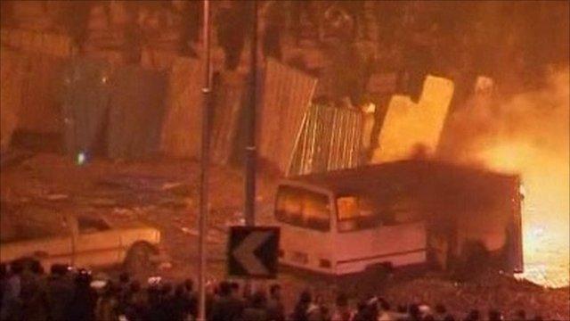 Burning bus on Tahrir Square