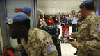 UN. soldiers escort UN staff based in Egypt after they arrive in Cyprus's Larnaca airport, on Thursday