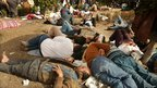 Anti-government protesters rest in Tahrir Square on Thursday