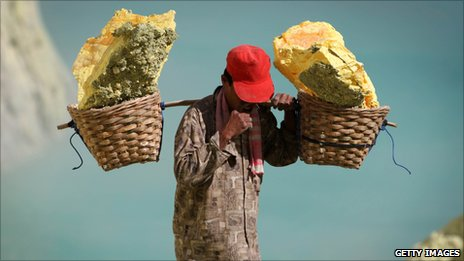 Miner with baskets of sulphur