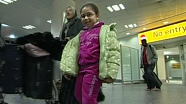 People arrive back at Gatwick airport from Cairo