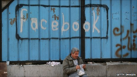 A gate sprayed with the word 'Facebook' in Tahrir Square