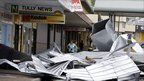Women survey the damage in Tully, Queensland, on 3 Feb 2011