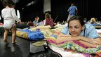 A young woman waits in an evacuation shelter in Innisfail, Queensland, on 2 February 2011