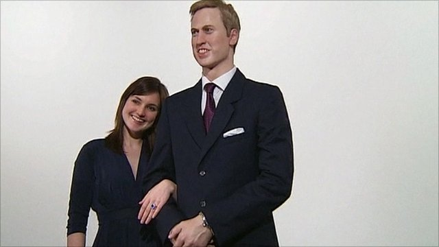 Woman stands next to model of Prince William