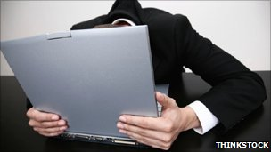 Man with head buried in laptop