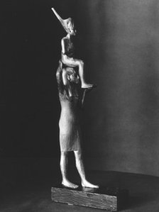Statue of Tutankhamen carried by a goddess (photo: Griffith Institute)