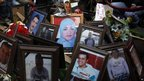 Pictures of Egyptians martyrs who killed during recent protests are seen at Tahrir Square.