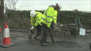 Pothole being repaired