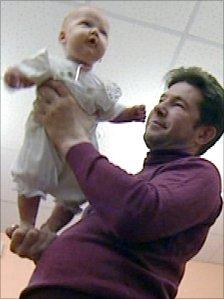 Oleg Tyutin and his granddaughter Varya