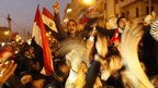 Egyptian anti-government protesters celebrate at Cairo's Tahrir Square after President Hosni Mubarak stepped down, 11 February 2011