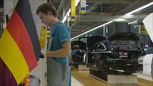 A worker in a German car factory