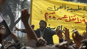 Public transportation workers strike for better pay and conditions in front of the national TV building in Cairo - 14 February 2011