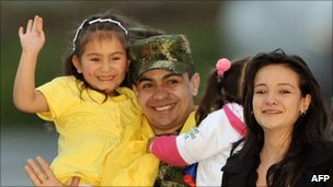 Salin Antonio Sanmiguel hugs his relatives upon his arrival to a military airport in Bogota, Colombia