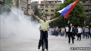 A man waves a Serbian flag during a protest in the divided town of Mitrovica (May 2010)