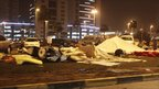 Anti-government demonstrators' damaged tents are seen at the Pearl roundabout in Manama, Bahrain, early Thursday morning, after riot police attacked them