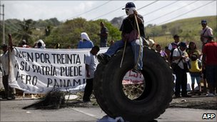 Indigenous Panamanians block the Pan-American Highway to protest recent changes to the country's mining law, on the outskirts of Panama City, 18 February 2011
