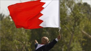 Man in Bahrain holds national flag during protests