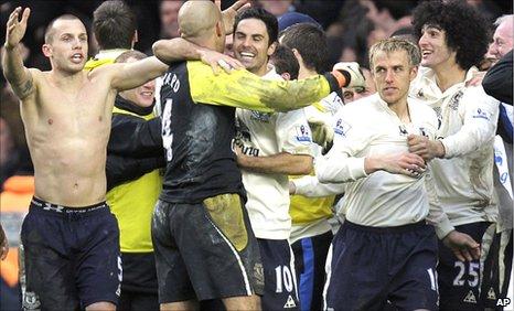 Everton celebrate Phil Neville's winning penalty