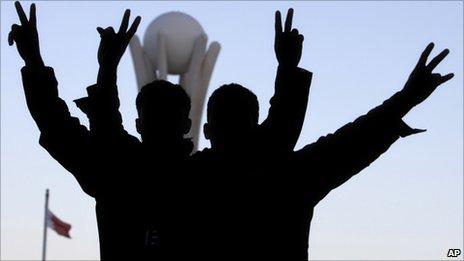 Bahraini protesters celebrates at the Pearl roundabout in Manama, Bahrain, 19 February 2011
