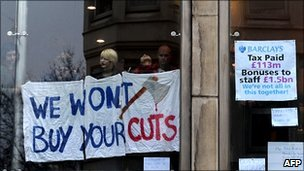 Protesters in a central London branch of Barclays Bank