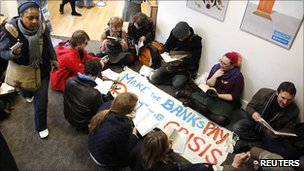 Protesters set up a makeshift library in a branch
