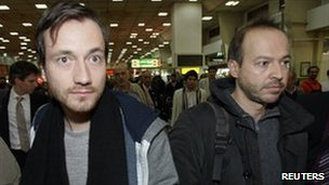 German journalists Jens Koch (left) and Marcus Hellwig arrive at Tehran's Mehrabad airport, 19 February