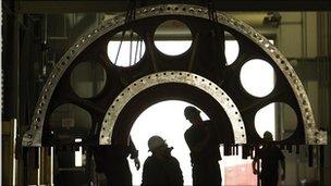 men examining a turbine