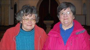 Jo Osment and Ann Hyland inside St Lawrence's Church, Folke