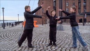 Jamie, Adam and Michael practise dancing together