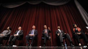 """Rahm Emanuel, third from right, speaks while Carol Moseley Braun left, Gery Chico second from left, Miguel Del Valle third from left, Bill """"Dock"""" Walls second from right, and Patricia Van Pelt Watkins right, look on during a Chicago Mayoral debate"""