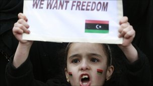 A child joins demonstrators protesting against Libya's Muammar Gaddafi outside the Libyan Embassy in London February 20, 2011.