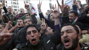Algerian protesters chant slogans during a demonstration in Algiers, 12 February 2011