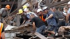 Rescuers search for survivors in a collapsed building on Manchester Street in Christchurch (22 February 2011)