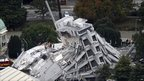 Rescue workers climb on to the collapsed Pyne Gould Guinness Building in central Christchurch on 22 February 2011