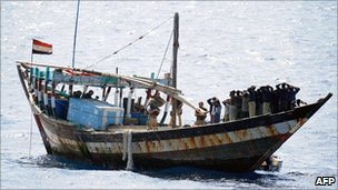 British military personnel securing the deck of a Somali pirate vessel