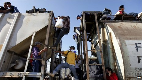 Central American migrants ride a northern bound train during their journey toward the US-Mexico border in Arriaga, in the state of Chiapas, southern Mexico, 3 February 2011