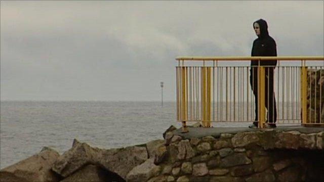 Young man looking across the Atlantic Ocean