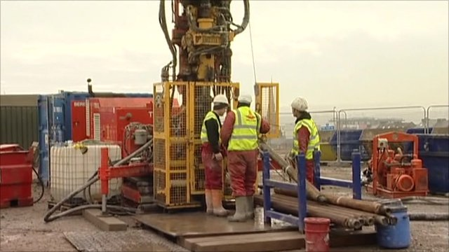 Engineers next to drilling equipment
