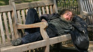 Man sleeping on a park bench