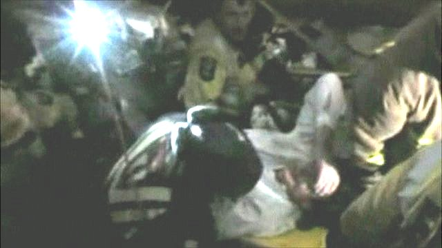 Earthquake victim being rescued