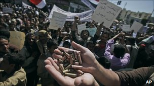 Anti-government protester in Sanaa, Yemen, holds up bullet shells he says were fired by government supporters at protesters the day before - 23 February 2011