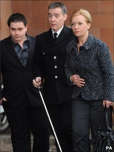Pc David Rathband arriving in court with his wife and son earlier in the trial