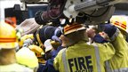 Rescue workers carry a female survivor after she was rescued from the ruins of a collapsed building in central Christchurch, 23 February 2011